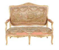 A French carved giltwood and upholstered settee in the Louis XV style