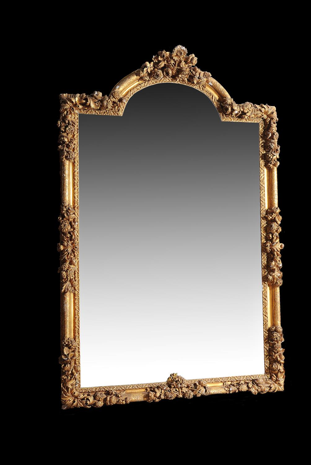 Lot 167 - A large and impressive giltwood mirror