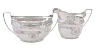 A George III silver oval sugar basin and cream jug