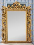 A substantial giltwood Florentine overmantel mirror