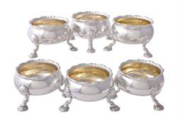 A matched set of six late George II silver cauldron salt cellars