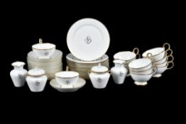 A Sevres hardpaste porcelain sparsely decorated and gilt part breakfast service