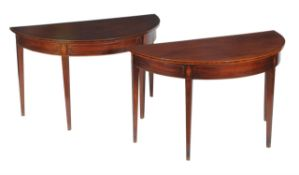 A pair of George III mahogany and inlaid side tables
