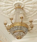 A gilt metal and glass eight light chandelier