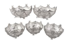 A suite of five Victorian silver shaped circular dessert baskets by Robert Harper