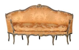 A Louis XV carved giltwood and painted sofa