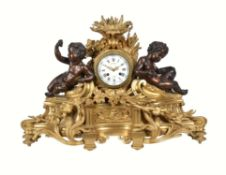 A late 19th century French ormolu and patinated bronze clock in the Louis XV style