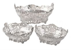 A matched suite of three Edwardian silver oval dessert baskets