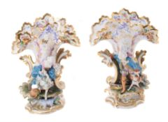 A pair of French biscuit and glazed porcelain figural frill vases