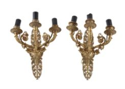 A pair of Charles X gilt bronze three light wall appliques