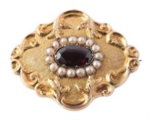 A mid Victorian gold, garnet and half pearl brooch