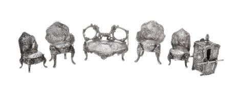 A collection of silver miniature furniture