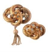 A mid Victorian foiled emerald and gold lovers knot brooch