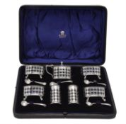 A cased seven piece cruet set by Haseler Brothers