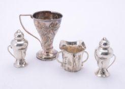 A pair of Art Nouveau silver pepperettes by John Round & Son Ltd.