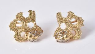 A pair of honeycomb diamond earrings