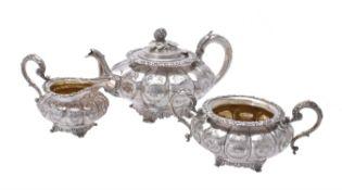 Y A George and William IV matched silver circular lobed three piece tea set by William Bateman II