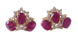 A pair of ruby and diamond ear studs