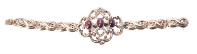 A mid Victorian gold and garnet bracelet