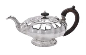 A George IV silver melon shaped tea pot by Charles Fox I
