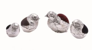 Four silver novelty pin cushions