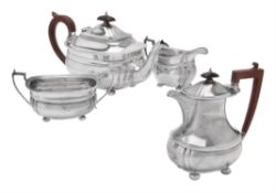 A silver four piece oblong baluster tea set by Adie Bros.