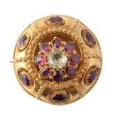 A mid Victorian gold, garnet and chrysoberyl brooch
