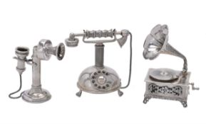 An Italian silver coloured miniature model of a gramophone and two telephones