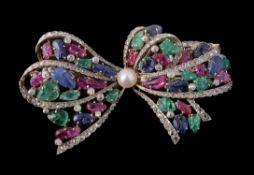 A multi gem set bow brooch
