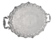 An Edwardian silver twin handled shaped oval tray by Barker Brothers