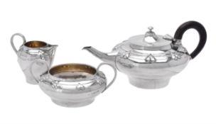 An Art Nouveau silver three piece tea set by Albert Edward Jones