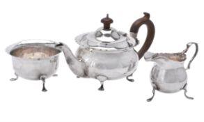 An Edwardian silver circular three piece tea set by George Nathan & Ridley Hayes