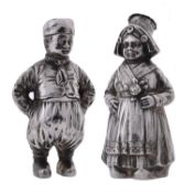 A pair of silver pepperettes modelled as a boy and girl