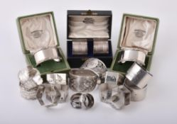 A collection of silver napkin rings