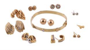 A 9 carat gold diamond set hinged bangle