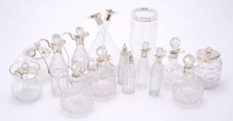 A collection of glass bottles and jars with silver mounts