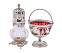 An Edwardian silver mounted clear glass sugar caster by William Comyns & Sons