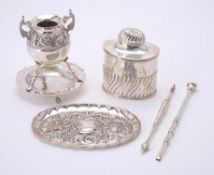 A collection of silver and silver coloured items