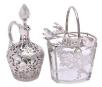 A silver encased clear glass liqueur decanter and stopper by The English Pure Silver Co.
