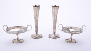 A pair of oval twin handled pedestal dishes