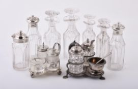 A collection of silver mounted cruet items