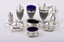 An Edwardian silver three piece cruet set by Haseler Brothers
