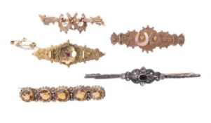 A small collection of antique brooches