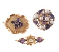 A Victorian amethyst and half pearl brooch