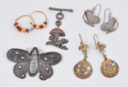 A pair of silver Aesthetic period butterfly ear pendants