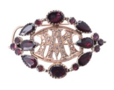 An early 20th century diamond garnet brooch