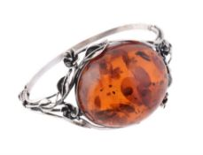 A clarified amber and silver coloured hinged bangle
