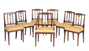 Y A set of seven mahogany dining chairs