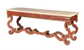 An Italian red painted and parcel gilt console table