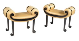 A pair ebonised and upholstered window seats or dressing stools in Art Deco taste